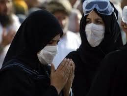 صورة حكم لبس الكمامة للنساء في العمرة , احكام العمره للمراه